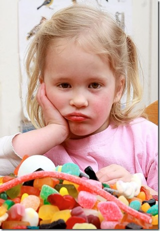 sulky kid with sweets